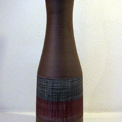 18. Brown, wine and black bottle vase with sgrafitto lines, Porcelain  h. 48cm