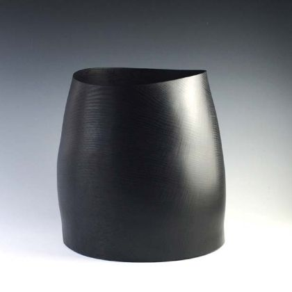 21. Ebonised Oak Barrel Form  28 x 28 cm