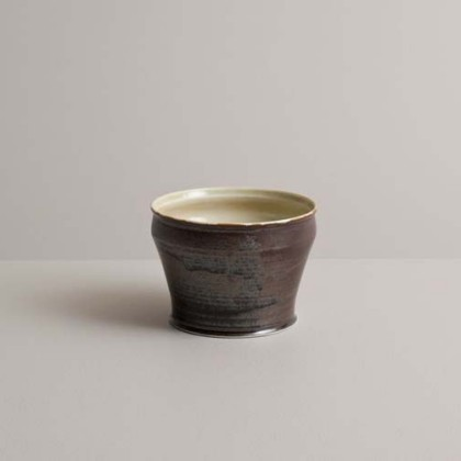 64. Flared-rim teabowl in ivory-green and bronze-black glazes,  Wheel-thrown porcelain 7.75 x 11 cm