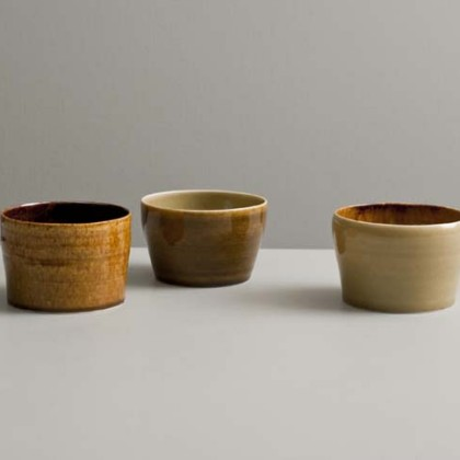 15.a, b & c Small cups in amber and golden  Glazes, Wheel-thrown porcelain Ht. 6.5 x diam 9.5 cm.