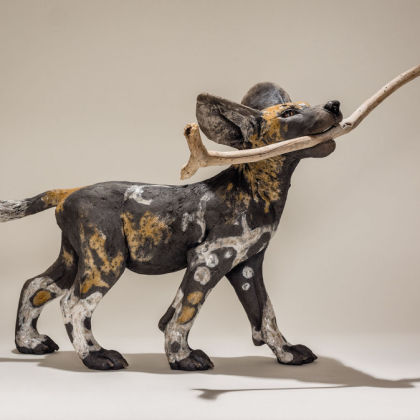 Nick Mackman Wild Dog Pup with Stick, Low-fired ceramic