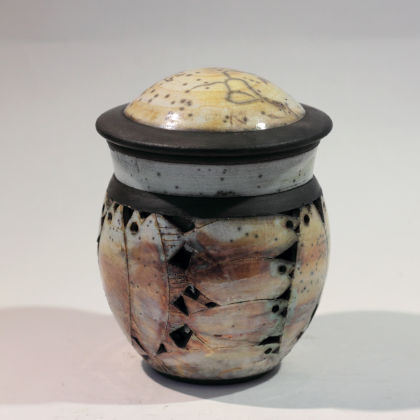 Rob Whelpton 17. Pierced lidded pot, Raku fired stoneware 15 x 13cm